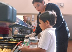 TCN students and parent volunteers at salad bar