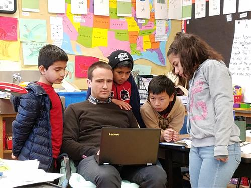 Teacher Corey Wallace works with students during class at Manzanita Community School