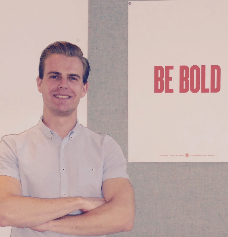 "Picture: Derrick McMillan with Poster ""Be Bold"""
