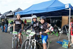 Female racers on mountain bike team.