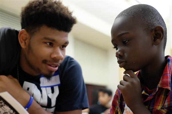 Oakland High student tutoring child