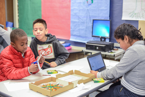 Students use math manipulatives