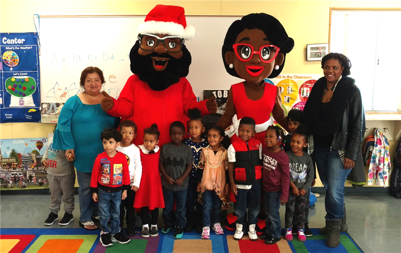Black Santa with students and staff