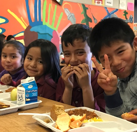 Kids smiling during lunch