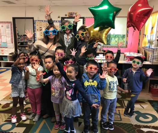 Students wearing star sunglasses with balloons