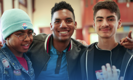 Three smiling male students