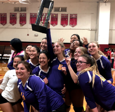 Girls Volleyball Team Celebrating with Trophy