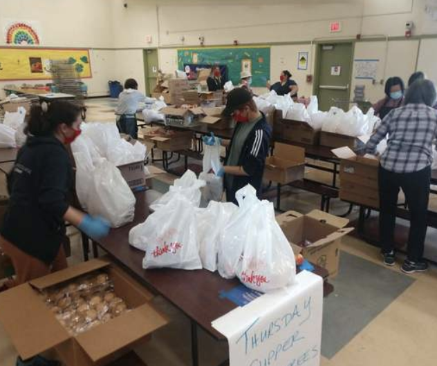 OUSD workers bagging food for giveaway