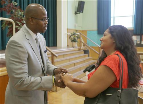 Superintendent Wilson meets a parent on the first day of school.