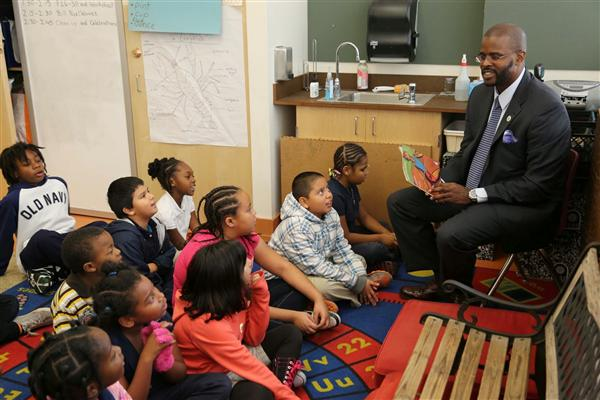 Supt. Wilson reads to students.