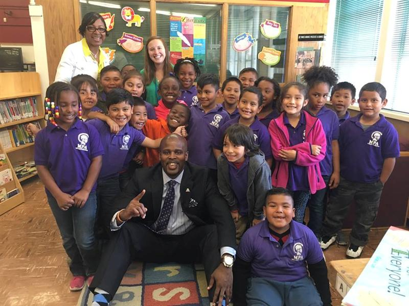 Supt. Wilson joins Madison Park students for a picture in the library.