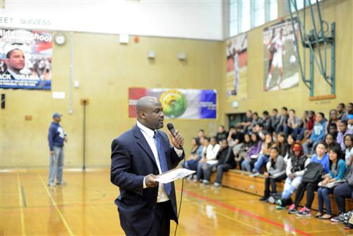 Principal Speaking to Students in Gym