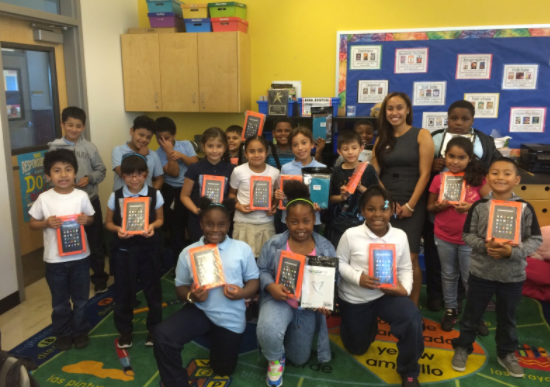 Students display their new Kindles.